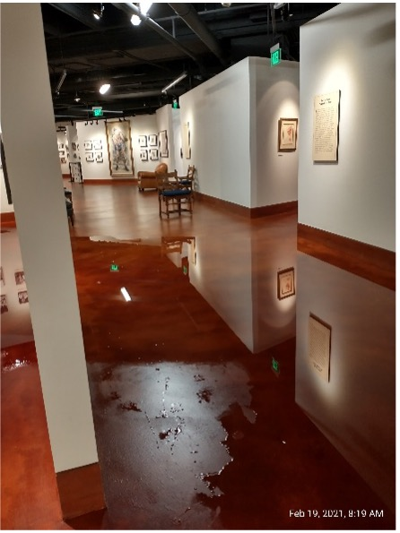Water in the main hallway of the gallery area.