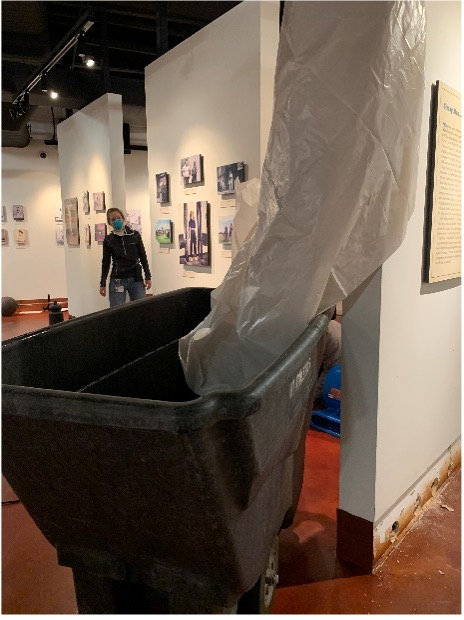 To keep the water from ruining the wall closest to it, we rigged up this plastic drape to direct the falling water into the cart.
