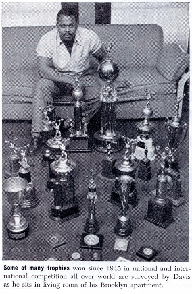 John Davis photographed with trophies for Ebony Magazine, May 1952.